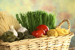Tagliatelle and Other Ingredients in Basket Royalty Free Stock Images