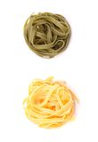 Tagliatelle paglia e fieno homemade. Tipycal italian pasta close-up on the white background Royalty Free Stock Photo