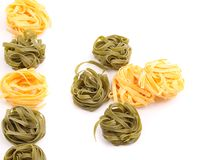 Tagliatelle paglia e fieno tipycal italian pasta. Royalty Free Stock Image