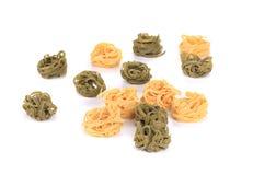 Tagliatelle paglia e fieno tipycal italian pasta. Stock Photos