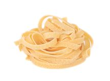 Tagliatelle paglia italian pasta. Isolated on a white background Royalty Free Stock Photo