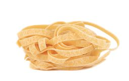 Tagliatelle paglia italian pasta. Isolated on a white background Royalty Free Stock Images