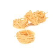 Tagliatelle paglia italian pasta. Isolated on a white background Stock Photography
