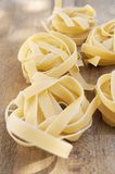 Tagliatelle pasta. Italian traditional pasta tagliatelle made with flour and eggs Royalty Free Stock Images