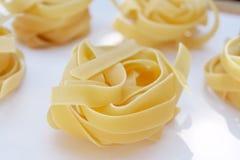 Tagliatelle pasta. Italian traditional pasta tagliatelle made with flour and eggs Stock Photography