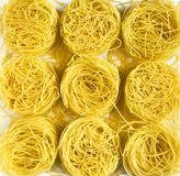Tagliatelle pasta background. Tagliatelle pasta - yellow abstract background Stock Image
