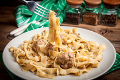 Tagliatelle pasta with beef meatballs. Stock Photos