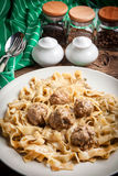 Tagliatelle pasta with beef meatballs. Stock Photography