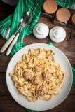Tagliatelle pasta with beef meatballs. Stock Image