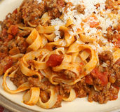 Tagliatelle Pasta with Beef Ragu. Garnished with grated Parmesan cheese Royalty Free Stock Photo