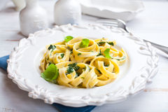 Tagliatelle Pasta with Blue Cheese Sauce and Spina royalty free stock photography