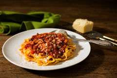 Tagliatelle pasta with bolognese ragu. Over a rustic table Royalty Free Stock Images