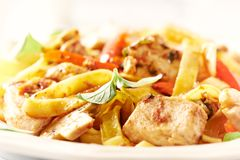 Tagliatelle pasta with chicken mushrooms, red pepper and onion. stock photography