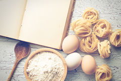 Tagliatelle pasta with cookbook Royalty Free Stock Photography