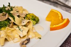 Tagliatelle pasta dish with broccoli and mushrooms Royalty Free Stock Image