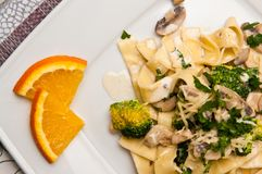 Tagliatelle pasta dish with broccoli and mushrooms Royalty Free Stock Photos