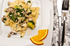 Tagliatelle pasta dish with broccoli and mushrooms Stock Images