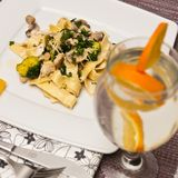 Tagliatelle pasta dish with broccoli and mushrooms Stock Photo