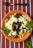 Tagliatelle pasta with fried mushrooms, top view Royalty Free Stock Photo