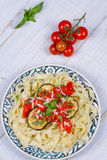 Tagliatelle pasta with grilled eggplant, spicy tomato sauce and parmesan cheese. Stock Images