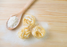 Tagliatelle pasta home made with flour and eggs. Preparation of traditional italian homemade pasta Royalty Free Stock Photo