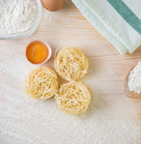 Tagliatelle pasta home made with flour and eggs. Preparation of traditional italian homemade pasta Stock Photography