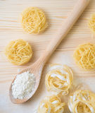 Tagliatelle pasta home made with flour and eggs. Preparation of traditional italian homemade pasta Stock Photos