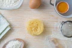 Tagliatelle pasta home made with flour and eggs. Preparation of traditional italian homemade pasta Stock Images