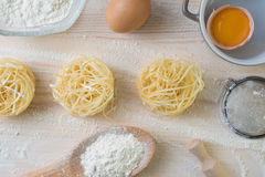 Tagliatelle pasta home made with flour and eggs. Preparation of traditional italian homemade pasta Royalty Free Stock Photography