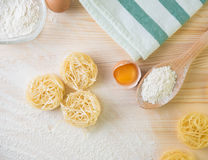 Tagliatelle pasta home made with flour and eggs. Preparation of traditional italian homemade pasta Royalty Free Stock Images