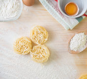 Tagliatelle pasta home made with flour and eggs. Preparation of traditional italian homemade pasta Royalty Free Stock Image