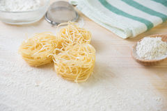 Tagliatelle pasta home made with flour and eggs. Preparation of traditional italian homemade pasta Stock Photo