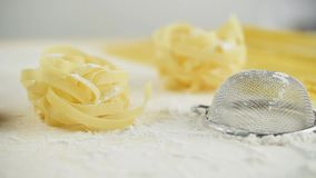 Tagliatelle pasta home made with flour and eggs track shot
