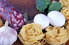 Tagliatelle pasta ingredients on wooden board Royalty Free Stock Photo