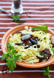 Tagliatelle pasta with mushrooms and parmesan cheese Royalty Free Stock Images