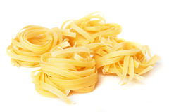 Tagliatelle pasta nest. Isolated on white background Royalty Free Stock Photo