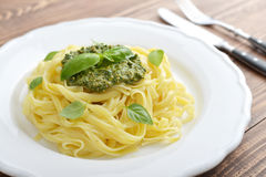 Tagliatelle pasta with pesto sauce Royalty Free Stock Photos