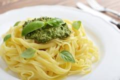 Tagliatelle pasta with pesto sauce Stock Photos