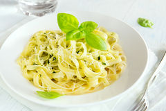 Tagliatelle pasta with pesto sauce Royalty Free Stock Images