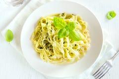 Tagliatelle pasta with pesto sauce Royalty Free Stock Photo