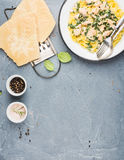 Tagliatelle pasta with salmon, spinach and creamy sauce, parmesan cheese over concrete textured background Stock Photo