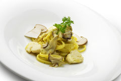 Tagliatelle pasta with scallops and porcini mushrooms Royalty Free Stock Images