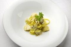 Tagliatelle pasta with scallops and porcini mushrooms Stock Photo