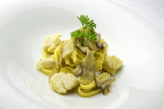 Tagliatelle pasta with scallops and porcini mushrooms Stock Photography