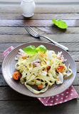 Tagliatelle pasta with seafood Stock Images
