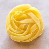 Tagliatelle Pasta. Single raw tagliatelle pasta close-up stock photo stock image