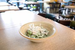Tagliatelle pasta with spinach, champignons and parmesan cheese on the plate in the restaraunt royalty free stock photo