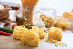 Tagliatelle pasta on a table. Raw tagliatelle pasta on a table Royalty Free Stock Photo