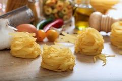 Tagliatelle pasta on a table. Raw tagliatelle pasta on a table Royalty Free Stock Photos