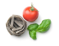 Tagliatelle pasta with tomato and basil leaf Royalty Free Stock Images